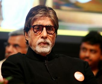 Big B finds bit of rhyme in day's work schedule