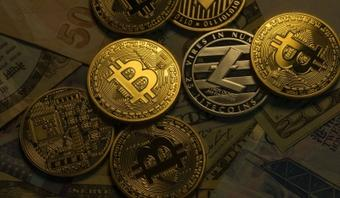 Bitcoin turns 12, crosses $34K for first time