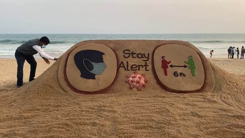 Sudarsan creates sand art on Covid awareness