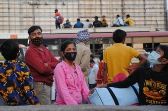 Delhi Lockdown: Migrants queue up at bus stands to rush home