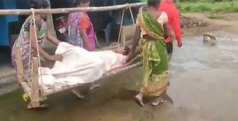 Pregnant woman delivers baby while being carried on cot in Rayagada