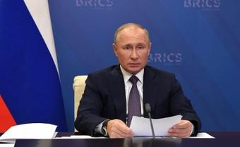 Putin urges global unity in combating Covid