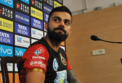 Kohli reprimanded for breaching IPL code of conduct